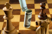 Chess with dollar and euro — Stock Photo