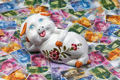 Swiss franc and piggy bank — Stock Photo