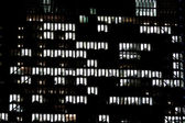 Lighted windows of an office building — Stock Photo