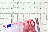 Ecg curve and ten € — Stock Photo