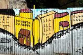 Graffiti on a fence — Stock Photo