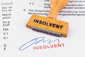Wooden stamp on the document: insolvent — Stock Photo