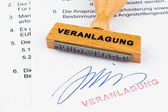 Wooden stamp on the document: assessment — Stock Photo