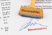 Wooden stamp on the document: taxpayer — Zdjęcie stockowe