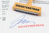 Wooden stamp on the document: service contract — Stock Photo