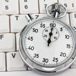 Stopwatch on computer keyboard — Stock Photo