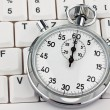 Stock Photo: Stopwatch on computer keyboard