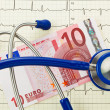 Stethoscope and ten euro note — Stock Photo