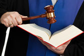 Judge with gavel and law book — Stock Photo