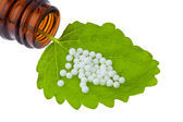 Homeopathy. globules as alternative medicine — Stock Photo