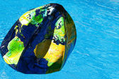 Water polo as a globe — Stock Photo