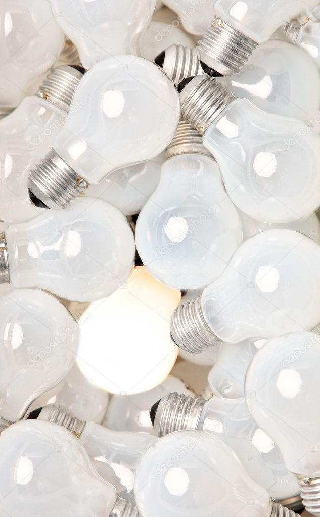 Many bulbs are next to each other. one of these lights — Stock Photo #8174518