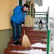 Woman at the snow removal — Stock Photo