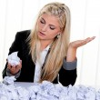 Woman with paper looks for ideas — Stock Photo