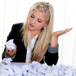 Woman with paper looks for ideas - Stock Photo
