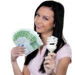 Woman with energy-saving lamp. — Stock Photo