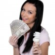 Woman with energy-saving lamp. — Stock Photo
