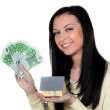 Woman with property and key — Stock Photo