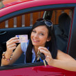 Young woman in the car with ingition — Stock Photo #8186085