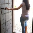 Woman emerges from a door — Stock Photo #8186089