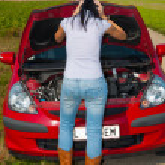 Woman has in her car breaks down — Stock Photo #8186107