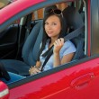 Womwith seat belt in car — Stock Photo #8186154