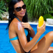 Woman with sunscreen at the pool — Stock Photo #8186179
