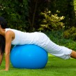 Woman with exercise ball - Stock Photo