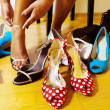 Woman with many shoes to choose from — Stock Photo