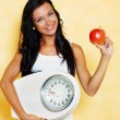 Woman with scales after a successful diet — Stock Photo #8186215