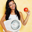 Woman with scales after a successful diet — Stock Photo