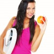 Woman with scales after a successful diet — Stock Photo #8186242