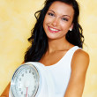 Woman with scales after a successful diet — Stock Photo #8186245