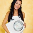 Woman with scales after a successful diet — Stock Photo #8186247