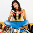 Woman with many shoes to choose from — Stockfoto