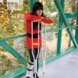Woman with leg in plaster and crutches in hospital — Stock Photo