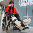 Woman with leg in plaster — Stock Photo