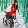 Woman with leg in plaster and crutches — Stock Photo