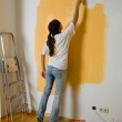 Woman colours her first flat — Stock Photo #8187023