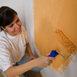 Woman colours her first flat — Stock Photo #8187038