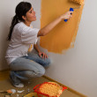 Woman colours her first flat — Stock Photo #8187061