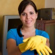 Stock Photo: Housewife is cleaning her flat