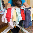 Ironing young woman with ironing board — Stock Photo #8187253