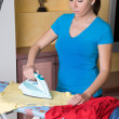 Ironing young woman with ironing board — Stock Photo #8187263
