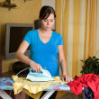 Ironing young woman with ironing board — Stock Photo #8187264