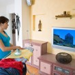 Ironing young woman with ironing board — Stockfoto