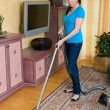 Housewife is cleaning her flat — Stock Photo #8187281