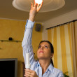 Young woman with energy saving bulb — Stock Photo #8187630