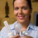 Young woman with energy saving bulb — Stock Photo #8187644