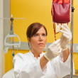 Nurse in hospital with blood products. — Stock Photo